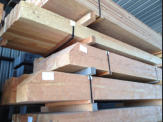 hand hewn timbers with detailed end cuts