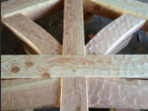 Close up of hand hewn mortise and tenon truss