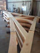 Mortise and tenon timber truss with curved webs